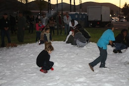 Children playing in the snow at MCAS Camp Pendleton Holiday gathering.