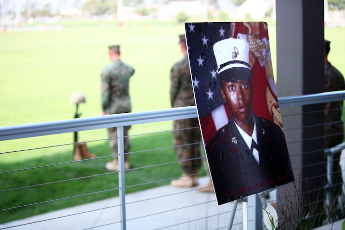 Lance Cpl. Anastasia Jackson's memorial photo sits on display while Marines who worked with Jackson line up to pay respects to her rifle memorial at Camp Pendleton, Calif., Dec. 12. Jackson, 26, from Philadelphia, died as the result of a diving accident near Mission Beach, Calif., Dec. 1.