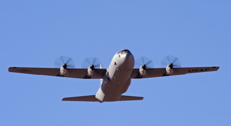 The newest C-130J flies over the flightline Dec. 13, 2012, at Dyess Air Force Base, Texas.  The aircraft was delivered by Maj. Gen. William J. Bender, U.S. Air Force Expeditionary Center commander, and is the 24th of 28 to be delivered to Dyess by 2013, replacing the legacy fleet of C-130Hs. Once the final aircraft is delivered, Dyess will be home to the largest C-130J fleet in the world. (U.S. Air Force photo by Airman 1st Class Peter Thompson/Released)