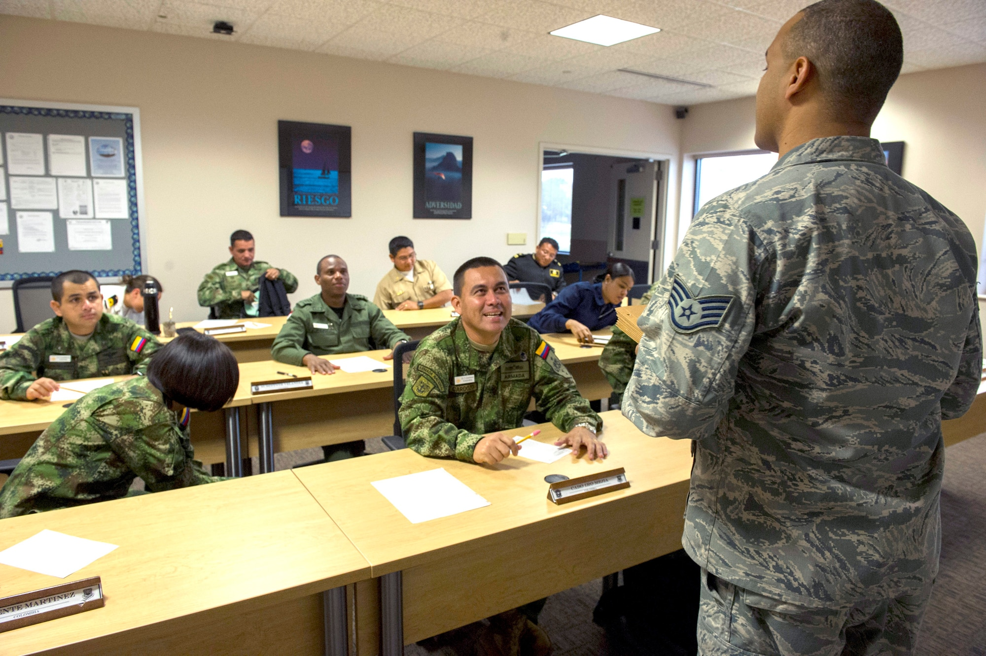 Staff Sgt. Jaime Torres, USAF instructor at the Inter-American Air Forces Academy, prepares students for their final exam in the International Logistics course, Joint Base San Antonio-Lackland, TX, Dec. 7, 2012. Thirteen partner nation students from Colombia, Dominican Republic, Panama, Ecuador, and Uruguay attended the International Logistics course during the last semester of 2012. The International Logistics course focuses on joint logistics principals, security cooperation and foreign military sales.    (US Air Force Photo by Staff Sgt. Marleah Miller)