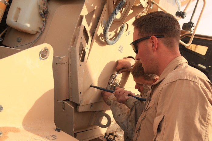 Marines with the motor transport section of Headquarters and Services Company, 2nd Battalion, 7th Marines, Regimental Combat Team 7, conduct vehicle maintenance on Combat Outpost Shamsher, Dec. 16, 2012. Vehicle maintenance is one of the many things COP Shamsher provides to the surrounding bases and districts in the battalion's area of responsibility.