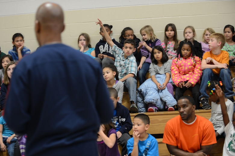 Kids listen to Derrick Stafford, National Basketball Association referee, speak at the Shaw Air Force Base youth center, S.C., Dec. 14, 2012.  Stafford is in his 25th NBA season and has served twice on the executive board of the NBA Referee Association.  (U.S. Air Force photo by Airman 1st Class Nicole Sikorski/Released)