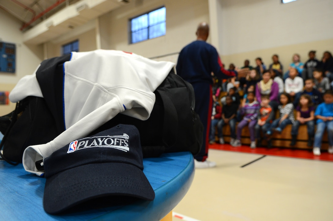 A National Basketball Association hat along with the belongings of Derrick Stafford, NBA referee, sits on a table as Stafford speaks to kids at the Shaw Air Force Base youth center, S.C., Dec. 14, 2012.  Stafford is in his 25th NBA season and has served twice on the executive board of the NBA Referee Association.  (U.S. Air Force photo by Airman 1st Class Nicole Sikorski/Released)