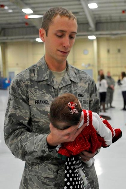 U.S. Air Force Technical Sergeant Trevor Frankel brings his daughter to see Santa Claus at the base Christmas Party at the 182nd Airlift Wing, Peoria, IL on Decmber 2, 2012.  (U.S. Air Force photo by Master Sergeant Scott Thompson/Released)