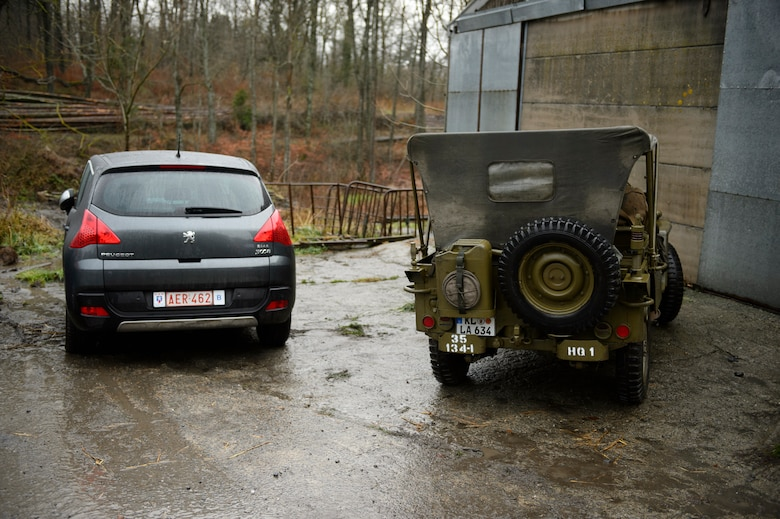 BASTOGNE, Belgium – A World War II era jeep is parked next to a newer car during the Bastogne Historic Walk Dec. 15, 2012. Memorabilia is not just limited to uniforms, insignias and weapons, but also includes standard-issue tents and vehicles from the era. (U.S. Air Force photo by Staff Sgt. Nathanael Callon/Released)