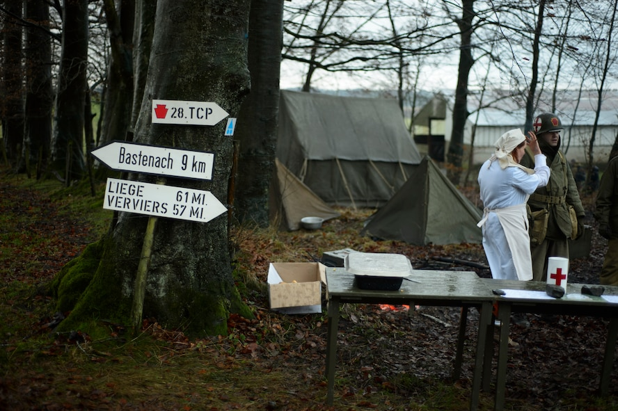 BASTOGNE, Belgium – Reenactors set up camp along the Bastogne Historic Walk route where U.S. forces defended against the German advance in December 1944. While some participants opt to stay in a hotel for the weekend, others decide to brave the frosty winter nights by camping outdoors. (U.S. Air Force photo by Staff Sgt. Nathanael Callon/Released)