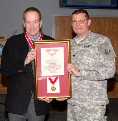 ERDC-CRREL Director Dr. Robert Davis and ERDC Commander Col. Kevin Wilson.  Davis received the Bronze Order of the de Fleury medal.