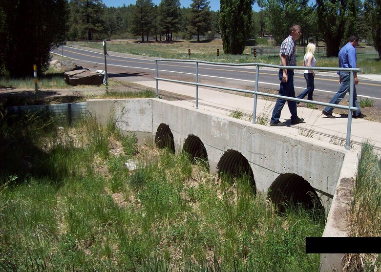 FLAGSTAFF, Ariz. -- Members of the U.S. Army Corps of Engineers Los Angeles District complete their inspection of the Thorpe Rd. culverts in May 2012 in preparation for work to be done by the District. The Corps completed construction on a new bridge which more than triples the flow capacity in the area.