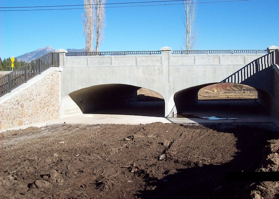 "FLAGSTAFF, Ariz. -- The U.S. Army Corps of Engineers Los Angeles District completed construction on a new bridge across Thorpe Rd which more than triples the flow capacity in the area. The ""classic-looking"" bridge project also contains retaining walls and the wing walls with a malapai rock veneer to provide aesthetic enhancement to the flood risk management project."