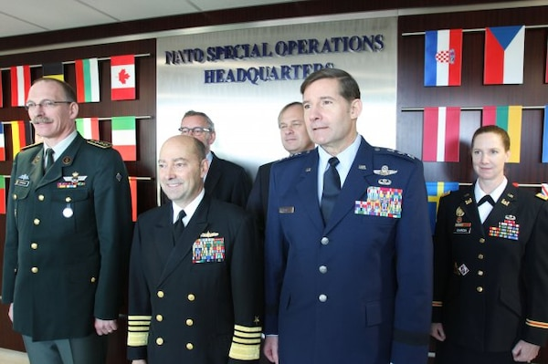 NATO special operations forces, comprised of 26 member nations and three non-NATO partners, celebrate the completion of a new state-of-the-art, 23,000-square-foot headquarters building during a ribbon-cutting ceremony Dec. 12 at SHAPE in Mons, Belgium. NATO's Supreme Allied Commander Europe, Adm. James Stavridis, center left, and Lt. Gen. Frank Kisner, NATO Special Operations Headquarters commander, addressed distinguished guests and expressed their desire for the building to serve as an ideas hub for 21st-century special operations.