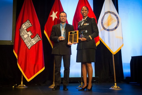 GRAPEVINE, TEXAS, -- Albuquerque District Commander Lt. Col. Antoinette Gant and Deputy for Small Business Programs Daniel Curado show the three awards the District received at the Society of American Military Engineers Annual Small Business Conference Dec. 12, 2012.  The District received the Special Small Business Champion of the Year Award, Historically Black College or University/Minority Institution (HBCU/MI)Star Award, and Top 10 Service Disabled Veteran-Owned Small Businesses percentage.