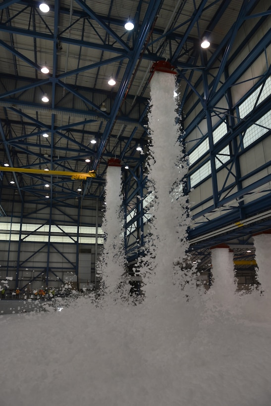 High expansion foam drops from the ceiling of the C-17 hangar during the fire protection test on March 31, 2011. The HEF expands to fill large enclosed spaces to suffocate fire.