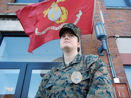 Lance Cpl. Kadie Tallentire stands in front of the Provost Marshall Office aboard Marine Corps Base Quantico on Tuesday. Tallentire is one of many Marines who will stand duty on Christmas Eve and Day.