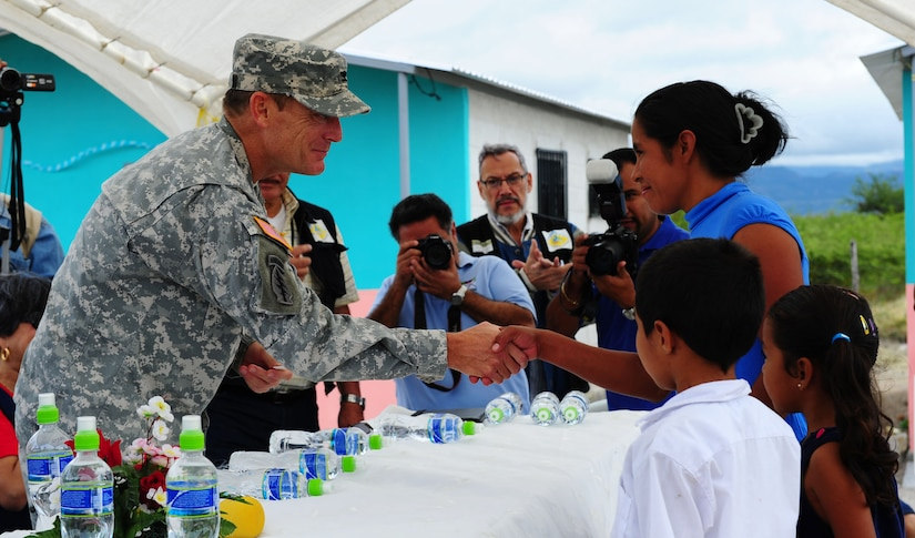 Colonel Guy LeMire, Joint Task Force-Bravo commander, shakes hands with one of the 61 families receiving a new home in Cane, Honduras. (U.S. Air Force photo/Capt. Rebecca Heyse)