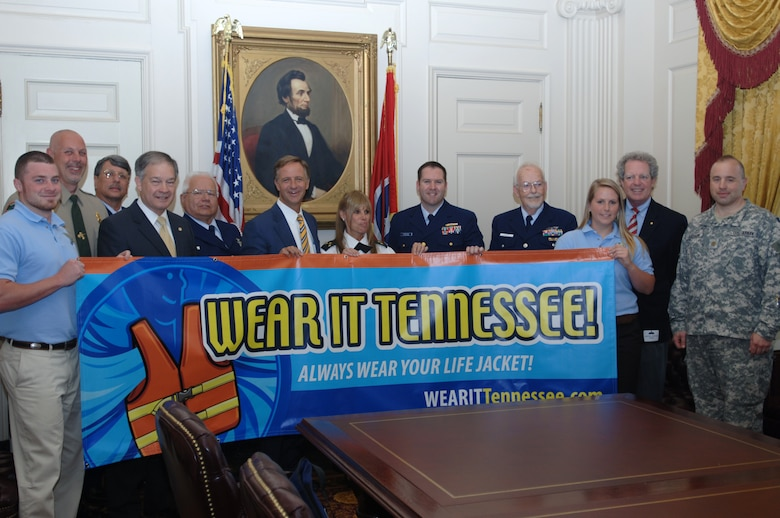 "Tennessee Gov. Bill Haslam (Center) poses with a ""Wear It Tennessee"" sign for a photo at the Tennessee State Capitol at Nashville, Tenn., May 18, 2011. (USACE photo by Lee Roberts)"