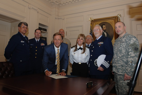 Tennessee Gov. Bill Haslam (Center) poses for a photo at the Tennessee State Capitol at Nashville, Tenn., May 18, 2011 with his proclamation for Safe Boating Week, which is May 21-27, 2011. The proclamation had previously been signed May 4, 2011 by the governor. Army Maj. William Judson (Far right), U.S. Army Corps of Engineers Nashville District deputy district engineer, represented the Corps at the event. Also represented are the U.S. Coast Guard Auxiliary, Music City Power Squadron, and Tennessee Wildlife Resources Agency. (USACE photo by Lee Roberts)