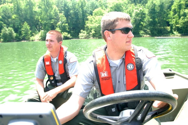 Park Rangers Spencer Taylor (Front) and John Malone, U.S. Army Corps of Engineers Nashville District, take a boat out on Martins Fork Lake in Smith, Ky., May 25, 2011.  Both rangers are participating in a one-year training program that will prepare them for permanent assignments as park rangers in the Nashville District. (USACE photo by Leon Roberts)