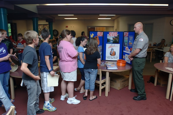 Laurel Lake Park Ranger Daniel Clark, U.S. Army Corps of Engineers Nashville District, interacts with fourth and fifth grade students May 26, 2011 during a Career Day event at Hunter Hills Elementary School in Corbin, Ky. (USACE photo by Lee Roberts)
