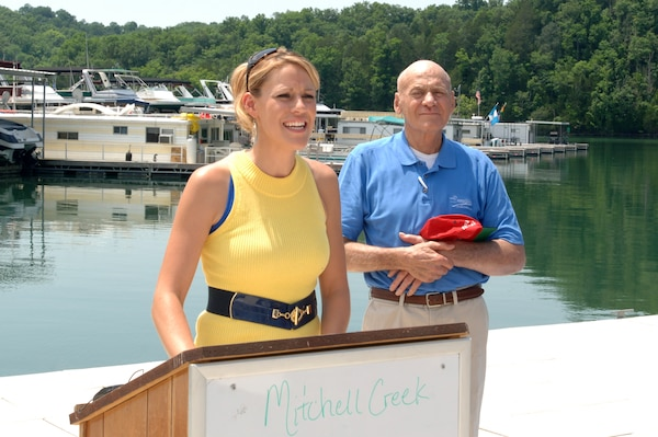 "April Smith, president of Mitchell Creek Marina in Allons, Tenn., comments at the end of a ""Clean Marina"" dedication ceremony June 3, 2011.  Her father and owner of the marina, Doug Smith, stands at her side.  (USACE photo by Lee Roberts)"