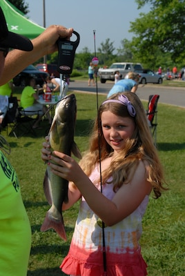 Ashley Eden, 11, from Hendersonville, Tenn., holds her prized catch of the day during the fishing rodeo, which lured hundreds of anxious and excited kids away from their video games and televisions June 11, 2011.