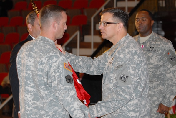 Maj. Gen. John W. Peabody, commander of the Great Lakes and Ohio River Division, passes the Nashville District colors to Lt. Col. James A. DeLapp who became the 62nd commander during a ceremony June 24, 2011 at the Grand Masonic Lodge in Nashville, Tenn.(USACE photo by Mark Rankin)