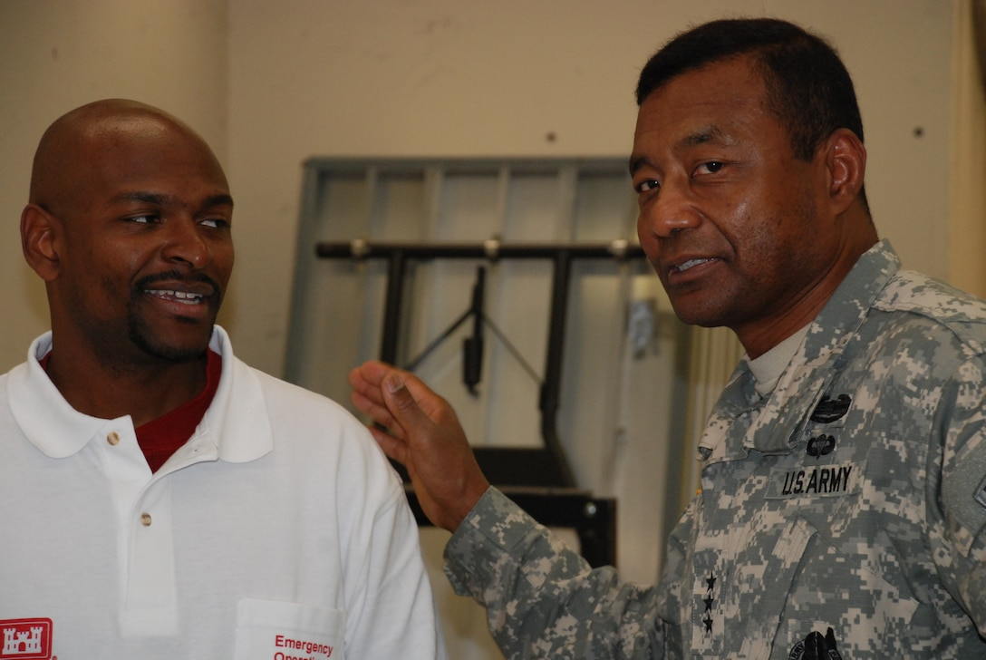 Chief of Engineers Lt. Gen. Thomas P. Bostick, right, visited the New Jersey Recovery Field Office, where he was briefed by Tim Brown, mission manager for the Housing Planning Response Team.