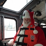 Santa plays it safe by wearing his life jacket when on the water.
