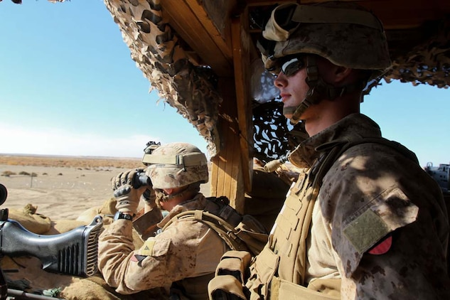 Lance Cpl. Kody Broderick, right, machine gunner, Weapons Company, 3rd Battalion, 9th Marine Regiment, Regimental Combat Team 7, stands post with Lance Cpl. Carl Adams, a mortarman with the company, Dec. 11, 2012. Adams jokes about Broderick being from North Pole, Alaska.