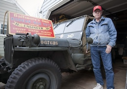 BALTIMORE—Donald Rollette, a retired Reserve Marine, stands beside his favorite collectable, an authentic World War II Marine Corps jeep, in front of his house in Baltimore, Oct. 16, 2012. Rollette has been collecting military items since he was 10 years old, eventually creating a personal museum in his basement. He takes the vehicle to many car shows and military displays where he won countless prizes for its authenticity. Just like all the pieces in his museum, it is an original vehicle with original parts. (U.S. Marine Corps photo by Cpl. Marcin Platek/Released)