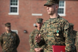 Maj. Matthew D. Reis, the adjutant of Combat Logistics Regiment 2, 2nd Marine Logistics Group, speaks to the Marines and sailors of CLR-2 after an award ceremony aboard Camp Lejeune, N.C., Dec. 11, 2012. Reis received the Navy and Marine Corps Commendation Medal for his exceptional situational awareness and immediate action while responding to a disturbance at a nearby barracks.