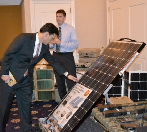 Congressman Eric Cantor, house majority leader (VA-07), examines the Ground Renewable Expeditionary Energy System after being briefed by Clint Govar (right), a Marine Corps Systems Command senior engineer with Expeditionary Power Systems, during a visit to Quantico, Va., earlier this month.