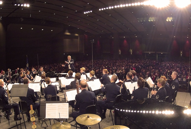U.S. Air Force Premier Concert Band Conductor Col. Larry Lang showcases the talents of Airmen musicians for thousands in attendance during the 66th Annual Midwest Clinic, Dec. 19, in Chicago, Ill. Every military band sets to exemplify the professionalism that is existent throughout everything in each one's branch of service. The non-verbal message that is communicated by the USAF Band's music is that every single task Airmen perform, across the globe, are done at this professional level. (U.S. Air Force photo by Senior Airman Steele C. G. Britton)