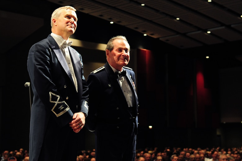 "U.S. Air Force Band Commander Col. Larry Lang and Col. Arnald Gabriel (Ret.), USAF Band commander 1964-1985, watch a video tribute dedicated to Gabriel during a performance at the 66th Annual Midwest Clinic, Dec. 19, in Chicago, Ill. ""The spirit, musicianship and enthusiasm--it's a tribute to what we're doing in our universities across the nation. The teaching is better than ever; so the bands and the Airmen themselves are playing better than ever."" Gabriel was presented the Midwest Clinic Medal of Honor during the final performance. (U.S. Air Force photo by Senior Airman Steele C. G. Britton)"