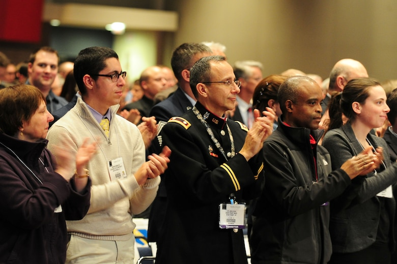 "Musicians, family, friends, mentors and fans of the U.S. Air Force Premier Band give a standing ovation following the third and final performance by the band at the 66th Annual Midwest Clinic, Dec. 19, in Chicago, Ill. ""This is one of the most amazing bands in the United States and in the world,"" said Christopher Poncin, high school band director in the state of Washington. ""They set the bar higher and higher every time I see them perform. We are fortunate and blessed here, at the Midwest Clinic, to see and experience an ensemble with such great conductors."" (U.S. Air Force photo by Senior Airman Steele C. G. Britton)"