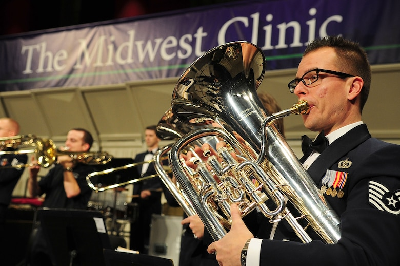 Tech. Sgt. Joseph Bello, U.S. Air Force Band euphonium player, performs alongside fellow Airmen musicians at the 66th Annual Midwest Clinic, Dec. 19, in Chicago, Ill. Every six years the USAF Band has the opportunity to perform at the clinic as they rotate the experience with fellow premier bands from each military branch stationed in Washington, D.C. (U.S. Air Force photo by Senior Airman Steele C. G. Britton)