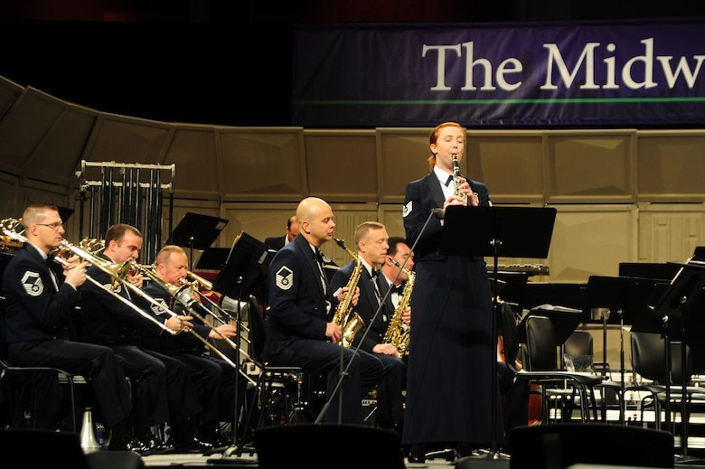 "U.S. Air Force Band Clarinetist Tech. Sgt. Kristin King performs a solo piece at the 66th Annual Midwest Clinic, Dec. 19, in Chicago, Ill. ""I was able to perform for my high school band director in the audience as well as my parents, grandpa and several students that I've taught here in Chicago which was really special for me,"" said King. ""It's a dream job to play alongside so many other wonderful professional musicians for amazing audiences here, in Washington, D.C., and across the country; it is just a fantastic experience."" (U.S. Air Force photo by Senior Airman Steele C. G. Britton)"