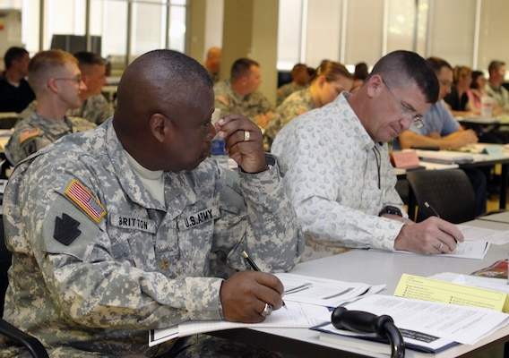 Transition Unit Soldier Maj. Lonnie Britton listens to instructions on how to fill out the Individual Transition Plan that is part of the new Transition Assistance Program, or TAP, July 23 at Fort Sill, Okla. Soldiers participated in the six-day long pilot program that launched the newly revised TAP program, which covers finances, job searches, resume preparation and more. Soldiers are now required to begin their preseparation counseling at least 12 months prior to the end of their military terms of service. Photo by Ben Sherman