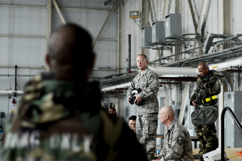169th Fighter Wing, Airmen participate in the Ability To Survive and Operate (ATSO) training in the base hanger, December 9, 2012, McEntire Joint National Guard Base, S.C. This training is being conducted in large venues throughout the December UTA to reduce time spent on computer based training and get a more hands on training to be prepared for the unit's upcoming Operational Readiness Inspection (ORI).   (National Guard photo by Staff Sgt Jorge Intriago/Released)