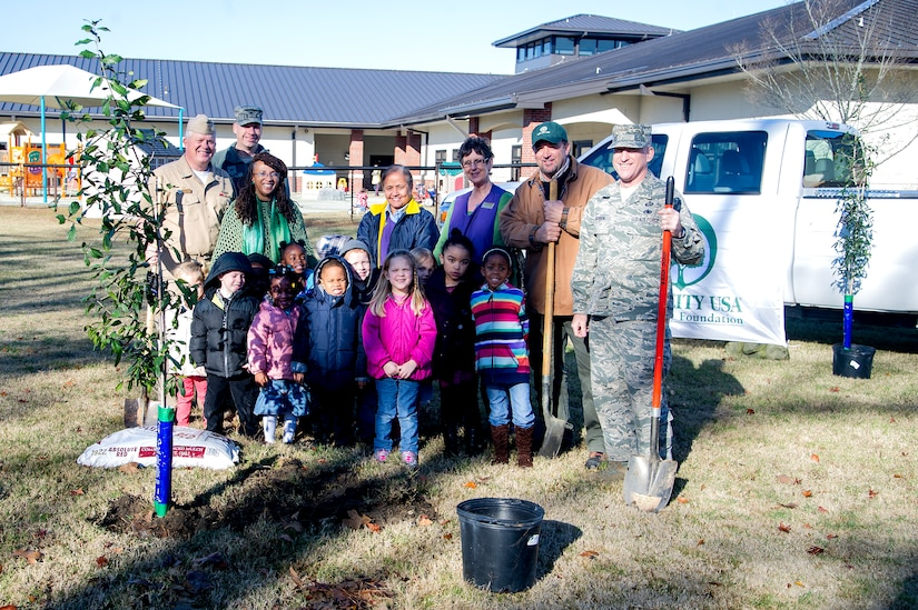 Capt. Thomas Bailey (far left), Keith Thompson (2nd from right), JB Charleston conservation program manager, Chief Master Sgt. Earl Hannon , 628th Air Base Wing command chief(far right), stand with kids and faculty members from the General Thomas R. Mikolajcik Child Development Center during an Arbor Day ceremony Dec. 14, 2012 at Joint Base Charleston - Air Base, S.C. This is the 17th year JB Charleston has been a member of the Tree City USA foundation. To become a Tree City USA member, a community must meet four annual standards: must be a tree protection board or manager, a tree care ordinance, a comprehensive community forestry program, and an Arbor Day observance. Bailey is the Joint Base Charleston deputy commander. (U.S. Air Force photo/Staff Sgt. Rasheen Douglas)