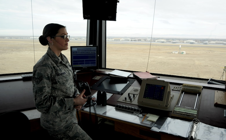 U. S. Air Force Senior Airman Jennifer Bradshaw, 366th Operations Support Squadron air traffic controller, stands inside the tower watching an aircraft land Dec. 13, 2012, at Mountain Home Air Force Base, Idaho. Air traffic control Airmen assigned to the 366th OSS respond and assist aircraft twenty-four hours a day. (U. S. Air Force photo/Senior Airman Benjamin Sutton)