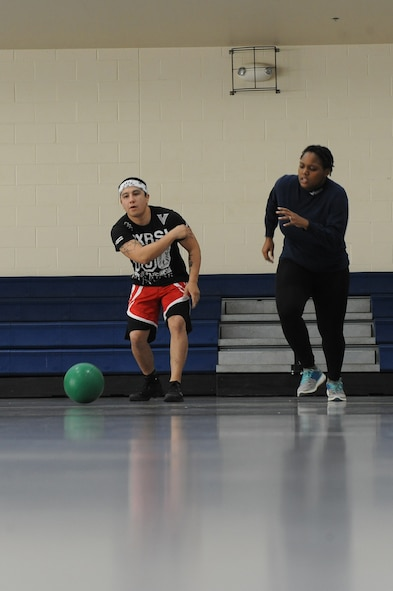 Staff Sgt. Jeremy Caudillo, 2nd Force Support Squadron fitness center supervisor, does an exercise drill with Staff Sgt. Crystal McElvane, 2 FSS unit deployment manager, on Barksdale Air Force Base, La., Dec. 20. During the drill, a ball is rolled and the other individual must run and retrieve it. The process is repeated for one minute to improve cardio. Caudillo competes in mixed martial arts and uses some of the exercises he learns to help Airmen stay fit to fight. (U.S. Air Force photo/Senior Airman Micaiah Anthony)