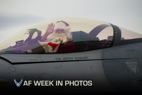 Santa, played by Col. Bryan Radliff, arrives in an F-16 Fighting Falcon to the 419th Fighter Wing Christmas party at Hill Air Force Base, Utah, Dec. 2, 2012. Radliff is the 419th FW commander. (U.S. Air Force photo/Senior Airman Crystal Charriere)
