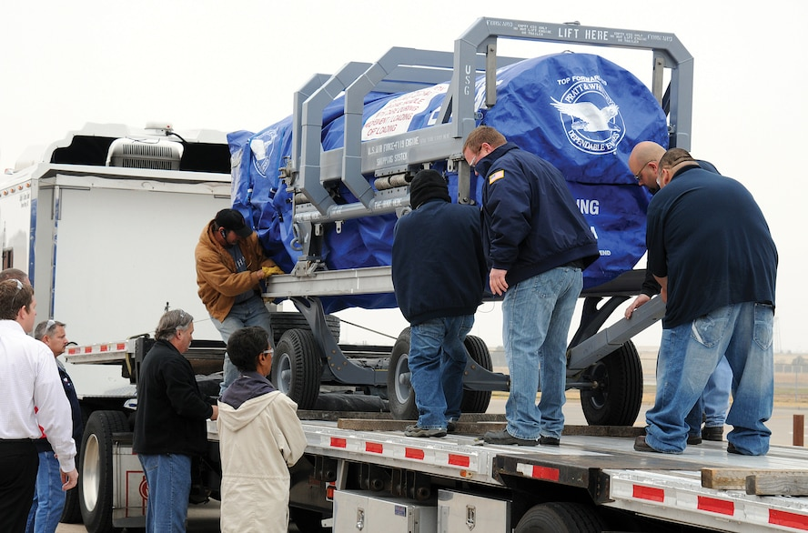 With careful precision, an F119 engine is secured on a flatbed trailer Dec. 7 outside the Oklahoma City Air Logistics Complex after a successful project test run. The detailed testing prepares the OC-ALC to produce engines in the F119 Heavy Maintenance Center operated here with Pratt & Whitney. (Air Force photo by Margo Wright)