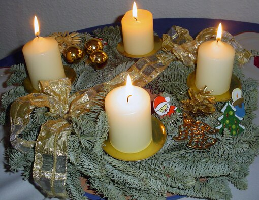 SPANGDAHLEM AIR BASE, Germany -- Most German families set up an Advent wreath in their homes. The Advent wreath became popular in northern Germany soon after World War I.  Since the 1930s, it's become popular throughout German-speaking parts of Europe. The wreath is made of fir branches with four candles, one of which is lighted on each Advent Sunday until all four are burning together. Then it's Christmas. The fourth candle will be lit Sunday, Dec. 23 at people's homes. (Courtesy photo/Released)