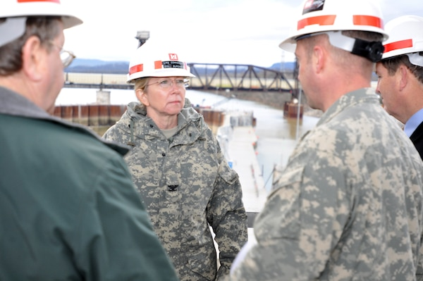Col. Margaret W. Burcham, U.S. Army Corps of Engineers Great Lakes and Ohio River Division commander,receives a briefing from Lt. Col. James A. DeLapp, Nashville District commander, and other project experts on site at the coffer dam at Chickamauga Lock in Chattanooga, Tenn., Jan. 12, 2012. (USACE photo by David Wheeler)