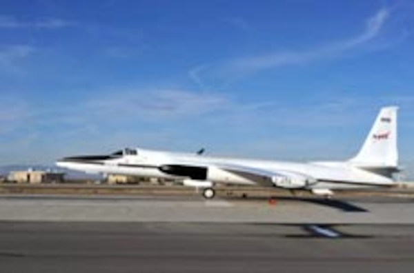 """In December 2010, an ER-2 aircraft lifts off with MABEL from NASA's Dryden Flight Research Center in Palmdale Calif., headed for a forested region in the Sierras. NASA scientists have previously measured tree heights and ground topography here, which will be used to better understand what MABEL """"sees"""" from the sky."""