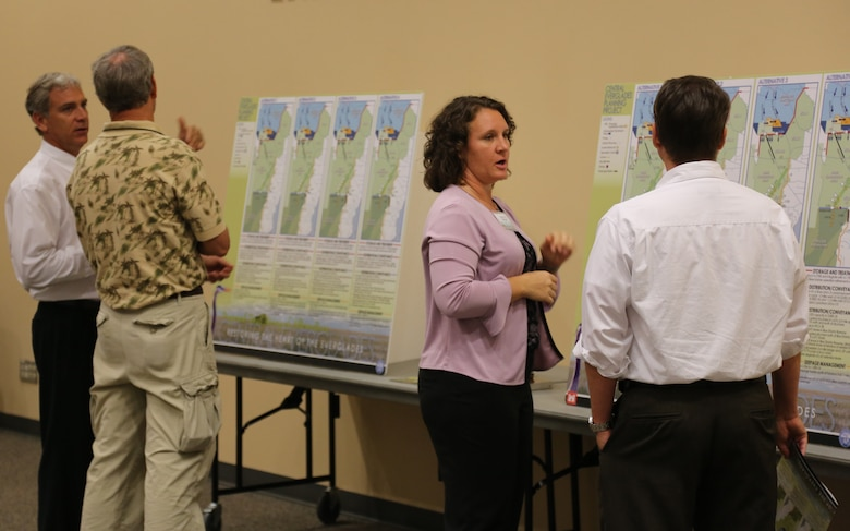 Matt Morrison (left), South Florida Water Management District project manager for the Central Everglades Planning Project (CEPP) and Gretchen Ehlinger(second from right), U.S. Army Corps of Engineers environmental lead for CEPP, explain the proposed final array of alternatives for CEPP at the Dec. 13 public meeting in Stuart, Fla. An open house was held at each of the five public meetings conducted throughout south Florida Dec. 10-13 and Dec. 18.