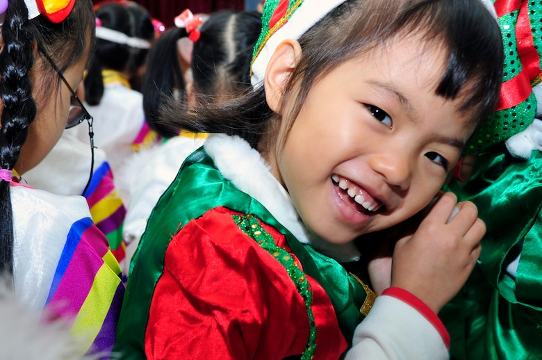 A Korean orphan smiles for a photo at a Korean orphanage Dec. 22, 2012. Team Osan gave back during the holidays by ensuring children in local orphanages received a little bit of cheer and a gift. (U.S. Air Force photo/Airman 1st Class Alexis Siekert)