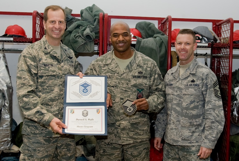 Col. Corey Martin, 376th Air Expeditionary Wing commander, and Chief Master Sgt. Bryan Creager, 376th Air Expeditionary Wing command chief notified Tech Sgt. Darnell Walls, 376th Expeditionary Civil Engineer Squadron Assistant chief of operations, of his promotion to the rank of master sergeant at Transit Center at Manas, Kyrgyzstan, Dec. 21, 2012. Wells received his promotion through the Stripes for Exceptional Performers program. Wells is currently deployed from Charleston Air Force Base, and is a native of Chicago, Ill. (U.S. Air Force / Staff Sgt. Stephanie Rubi)