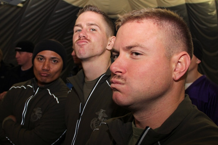 Sgt. Jeremias Orden, Sgt. Jacob Bucinski and Staff Sgt. Paul Schmotter show off their mustaches during the Recruiting Station Twin Cities annual flag football tournament at the St. Croix Valley Recreational Center Nov. 18. The Rochester, Minn., recruiters were among 30 people who grew out their facial hair to promote early cancer detection and ultimately reduce the number of preventable deaths.